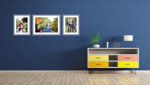 Framed prints on a colourful and modern wall