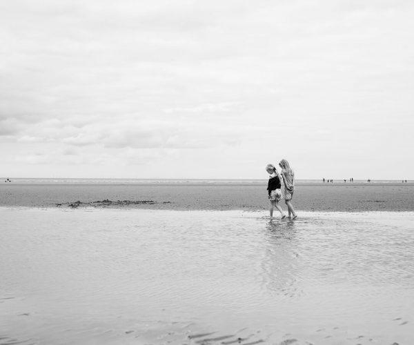 Two girls walking on Old Hunstanton beach
