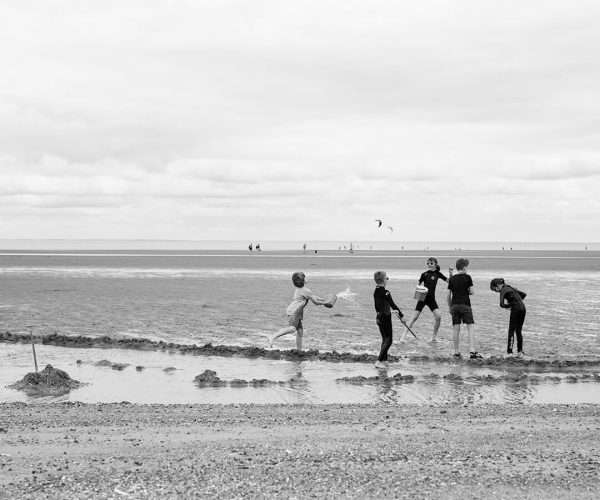 An image of children playing on the beach in Norfolk